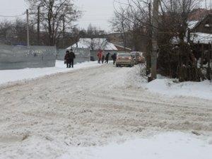 Фото: Полтавці не встигають боротись зі снігом: фоторепортаж