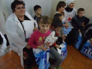Фото: У Полтаві Святий Миколай у образі мера вітав хворих дітей зі святом і слухав віршики (фото)