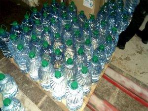 Фото: У підпільному цеху вилучили більше 10 тонн спирту й готівку